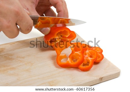 Cutting pepper on the board isolated on white background