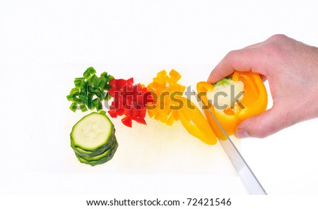 Cutting peppers in the kitchen. - stock photo