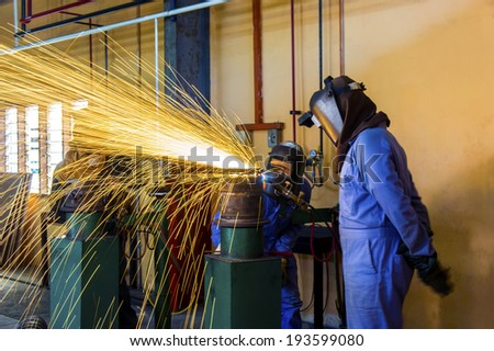 cutting pipe work with acetylene gas - stock photo