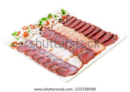 Cutting sausage and meat - stock photo