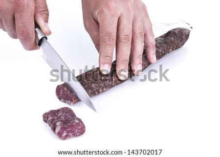 Cutting sausage, typical Spanish food