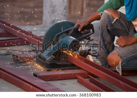 Cutting Steel channel (steel C chanel) with grinder. Sparks while grinding iron