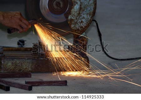cutting steel with machine for cutting steel by worker