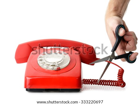 Cutting telephone cord isolated on a white background