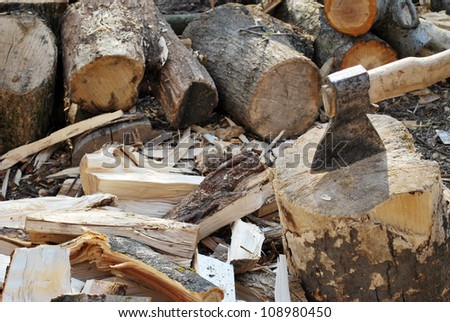 Cutting the wood with ax - Stock Photo