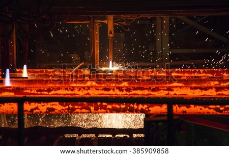 cutting torch in metallurgical plant - stock photo