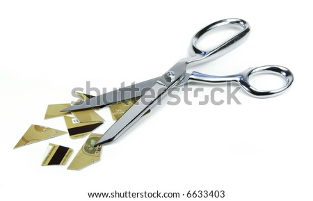 Cutting up a credit card with scissors. - stock photo