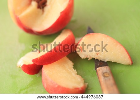 Cutting up a fresh, juicy peach into slices with a paring knife