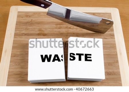 Cutting Waste with a Cleaver and Cutting Board. - stock photo