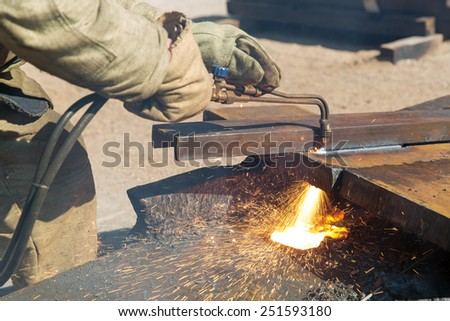 Cutting welding works with propane oxygen gas blow torch burner - stock photo