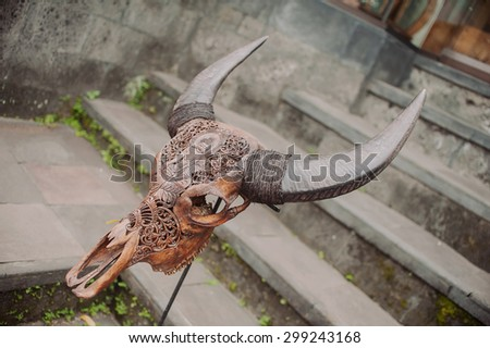 Cutting with a cow skull pattern - stock photo