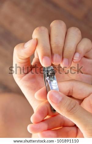 Cutting your fingernails - stock photo