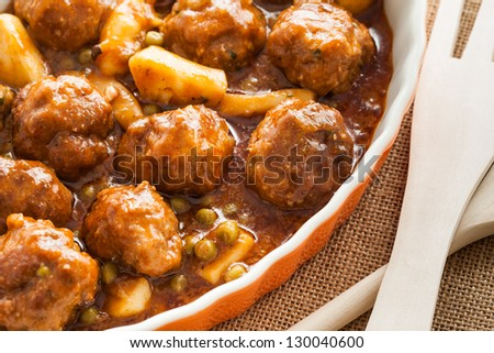 Cuttlefish with meatballs and peas. Typical spanish dish. - stock photo