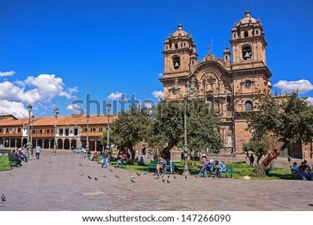 CUZCO, PERU - CIRCA 2012: Panoramic view of the Cuzco street circa 2012 in Cuzco, Peru. Cuzco is the most important travel destiny of Peru. - stock photo