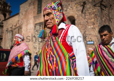 CUZCO, PERU - SEPTEMBER 7: Unknown Peruvian people in traditional clothes on a carnival in Cuzco, Peru, 7 Septiembre 2014. Every year in Cuzco passes many religious holidays and carnivals