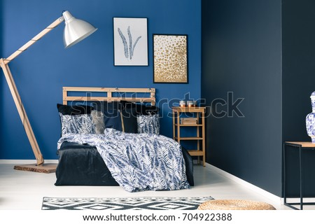 Lovely Cyan Bedroom Interior With Wooden Furniture And Decorative Rug