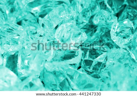Cyan broken glassy cubes. Toned - stock photo