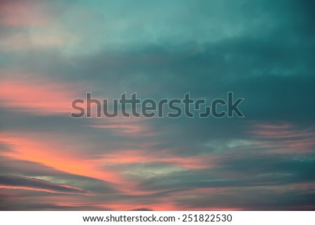 Cyan clouds and fire sunset background.Orange sunset. - stock photo