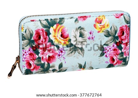Cyan feminine purses / studio photography of cosmetic bag with pattern flowers - isolated on white background - stock photo