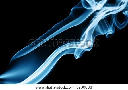 Cyan smoke trails, on black background. - stock photo