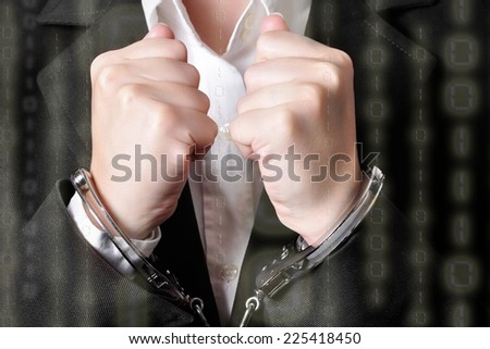 Cyber crime concept. Closeup of an handcuffed businessperson in a black suit with binary code on top