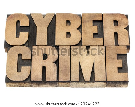 cyber crime - isolated text in vintage letterpress wood type printing blocks