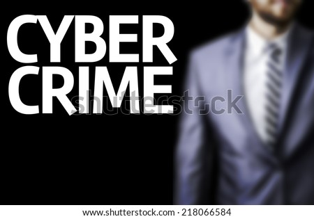 Cyber Crime written on a board with a business man on background - stock photo