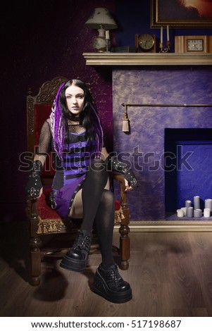 Cyber gothic girl in a dark room interior