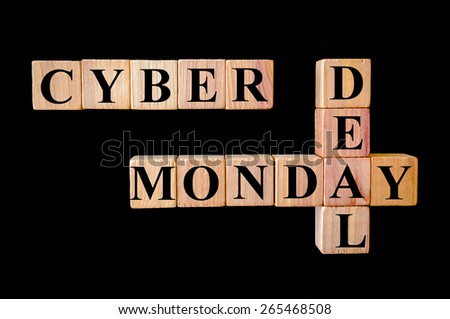 Cyber Monday Deal.Retail Sales concept image.Wooden small cubes with letters forming crossword puzzle isolated on black background. - stock photo