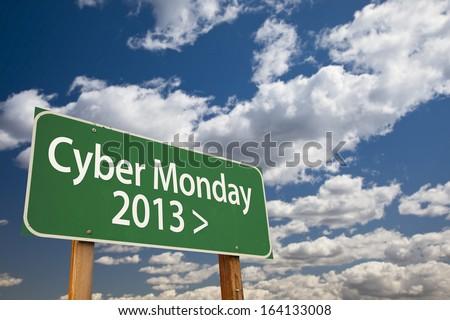 Cyber Monday 2013 Green Road Sign with Dramatic Clouds and Sky. - stock photo