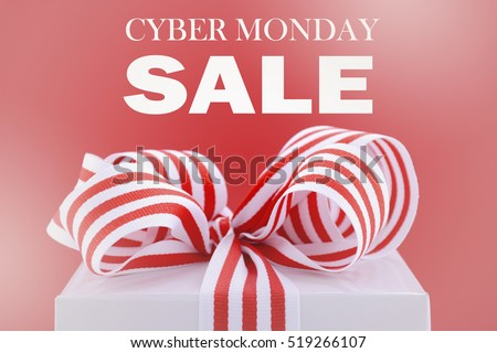 Cyber Monday red and white sales promotion gift box closeup against a red background, with applied faded filters.