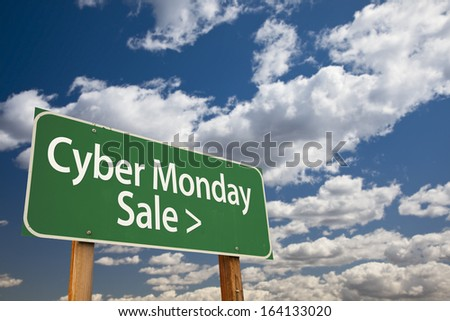Cyber Monday Sale Green Road Sign with Dramatic Clouds and Sky. - stock photo