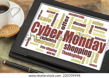 Cyber Monday word cloud  on a digital tablet with a cup of coffee - a holiday online shopping concept - stock photo