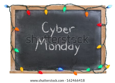Cyber Monday written in white chalk on a black chalkboard surrounded by festive colorful lights isolated on white - stock photo