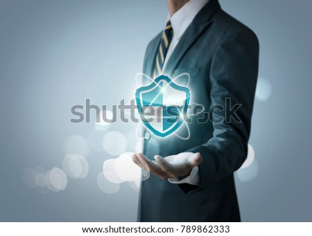 Cyber security, internet security or information protection service concept. Businessman is holding a cyber security icon on bright tone background.