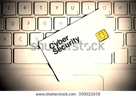 Cyber security. Smart card on a white laptop keyboard. - stock photo