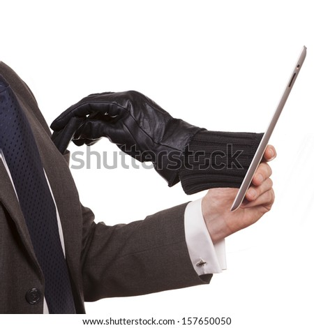 Cyber theft being committed through a tablet computer. A man wearing a suit is holding a tablet computer while an arm is reaching through screen to steal wallet from pocket. white background.  - stock photo