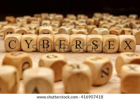 Cybersex word written on wood block - stock photo