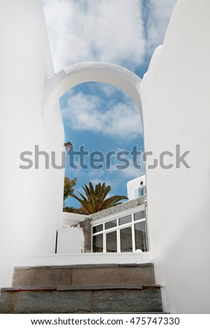Cyclades architecture on a outdoor place in a Greek island with a beautiful blue sky