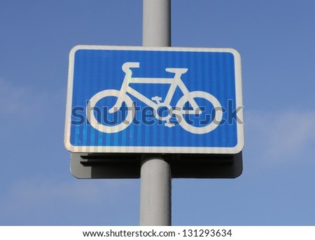 Cycle lane rectangular sign against a blue sky. - stock photo