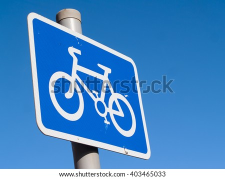 Cycle lane sign, blue, on a steel pole,  in the UK.