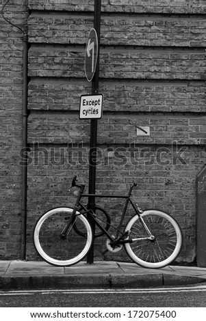 Cycle tied to post, Old Street, City of London - stock photo