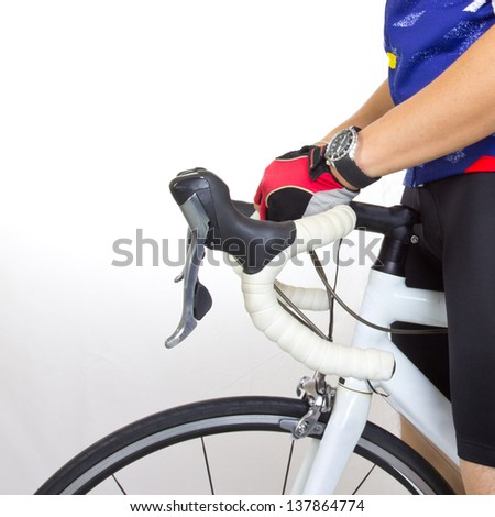 Cycler riding on bicycle in racing tour - stock photo