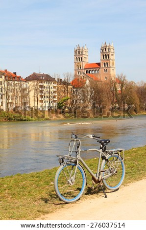 cycling along the riverside of isar river, munich, germany - stock photo