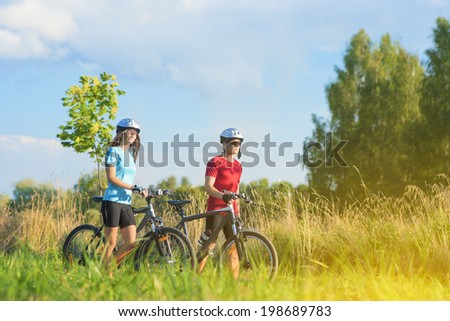 Cycling Athletes Exercising with Bicycles in Nature Environment Outdoor. Horizontal Image