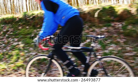 cycling competition or exercise on a bike. motion blur biker - stock photo