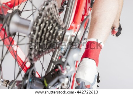 Cycling Concepts and Ideas. Back View of the Athlete Leg Inline with Rear Derailleur and Cassette Sprokets. Back View. Horizontal Image