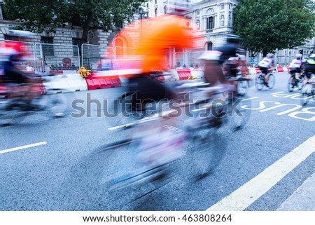 Cycling event in London - blurred cyclists riding on the road.