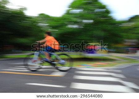 Cycling in slow motion - stock photo