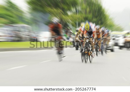 Cycling, motion blur - stock photo